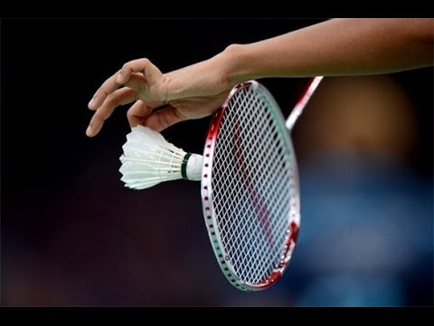 serving a badminton shuttlecock